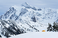 Winter backcountry campsite with Mount Shuksan in the background, North Cascades, Washington