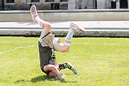 Scranton, Pa. - A man tumbles in the grass after the Color Me Rad 5K color run on May 24, 2015.