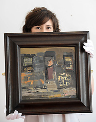 Pictured: Arianna Pedrazzoli from Lyon & Turnbull auctioneers with the painting.<br /> <br /> A rare painting by celebrated Scottish artist Joan Eardley, 'Glasgow tenement with graffiti', which is expected to fetch up to £30,000 GBP when it comes up for sale next month, was previewed at Lyon and Turnbull in Glasgow.<br /> <br /> © Dave Johnston / EEm