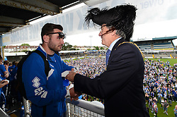 Lord Mayor of Bristol Alastair Watson presents Bristol Rovers' Jake Gosling with his medal - Photo mandatory by-line: Dougie Allward/JMP - Mobile: 07966 386802 - 25/05/2015 - SPORT - Football - Bristol - Bristol Rovers Bus Tour