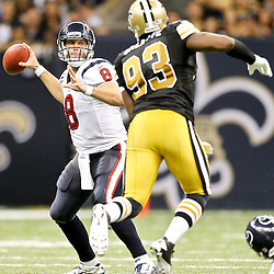 September 25, 2011; New Orleans, LA, USA; Houston Texans quarterback Matt Schaub (8) is pressured by New Orleans Saints defensive end Junior Galette (93) during the third quarter at the Louisiana Superdome. The Saints defeated the Texans 40-33. Mandatory Credit: Derick E. Hingle