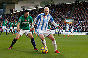 Huddersfield Town's Aaron Mooy  shields the ball from West Bromwich Albion's Gareth Barry  during the Premier League match between Huddersfield Town and West Bromwich Albion at the John Smiths Stadium, Huddersfield, England on 4 November 2017. Photo by Paul Thompson.