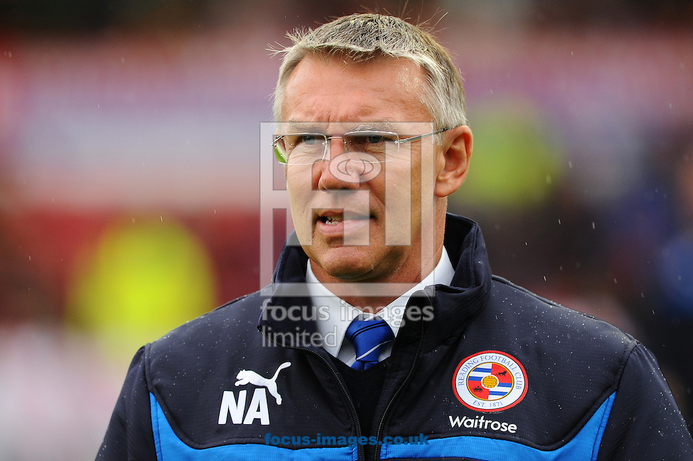 Manager of Reading Nigel Adkins during the Sky Bet Championship match at Griffin Park, London<br /> Picture by Seb Daly/Focus Images Ltd +447738 614630<br /> 04/10/2014