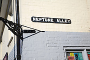 Neptune Alley street sign on building, Aldeburgh, Suffolk