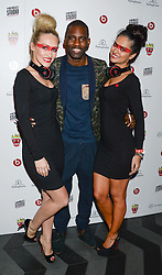 WRETCH 32 and models at a party hosted by Beats by Dre to celebrate the launch of Tinie Tempah's new album and to celebrate his birthday held at DSTRKT, Rupert Street, London on 7th November 2013.