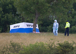 © Licensed to London News Pictures. 08/06/2020. London, UK. A police forensics officer walks past an evidence tent at Fryent Country Park near Wembley, north London. According to reports, two women were found unresponsive and were pronounced dead at the scene yesterday. Photo credit: Peter Macdiarmid/LNP