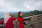 Panorama Langkawi. Girls with headscarfs taking souvenir photos.