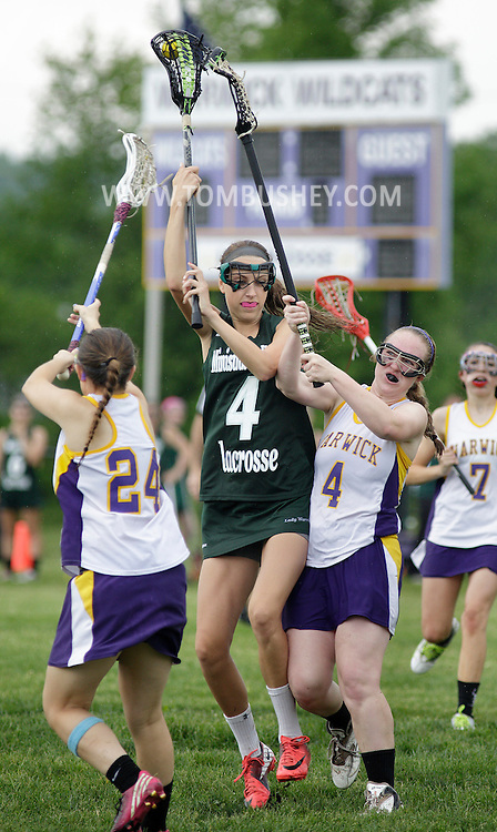 Minisink Valley's Genna Gross carries the ball between Warwick's Emily Gerbehy, left, Shannon Darcy during a game in Warwick on May 23, 2013.