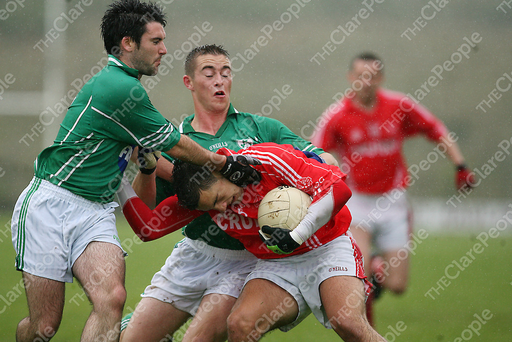 Kilrush's Mathew Moloney and Cathal Lyons close down Eire Og's Dean Ryan during their game in Kilmihil on Sunday.<br /> Photograph by Yvonne Vaughan