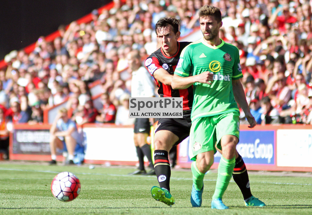 Fabio Borini Plays a pass under pressure from Charlie Daniels of Bournemouth (left) During Bournemouth vs Sunderland on Saturday 19th September 2015.