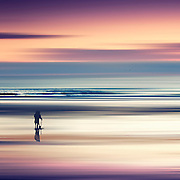 Two people at the beach at sunset - abstract seascape<br />