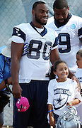 Dallas Cowboys rookie tight end Rico Gathers (80) poses for a photograph with a young fan during the second day of the Dallas Cowboys 2016 NFL training camp football practice held on Sunday, July 31, 2016 in Oxnard, Calif. (©Paul Anthony Spinelli)