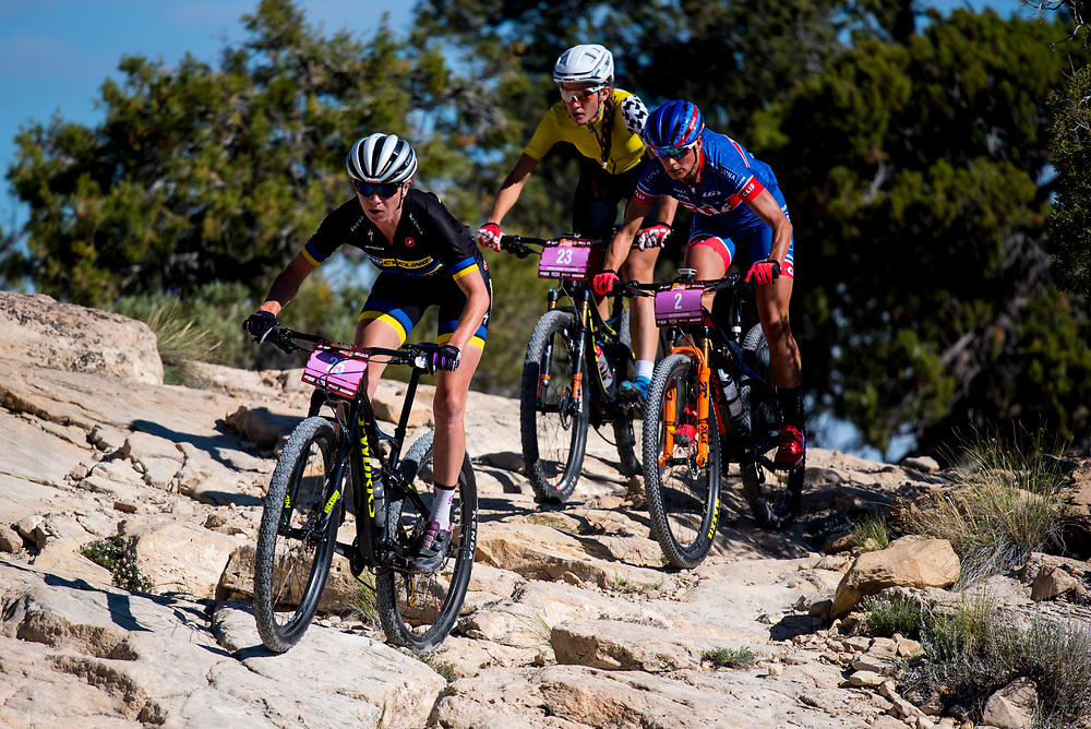 Amy Beisel leads Katerina Nash and Sofia Gomez Villafane down a technical section of the Tabeguache trail on Sunday.