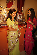 Kalpa Kasliwal and Edite, Treasures From The Gem Palace, Private view of gem stones created by a family of Indian court jewellers from Jaipur (the Kasliwals). Somerset House, London, WC2, 28 September 2006. www.somerset-house.org.uk-DO NOT ARCHIVE-© Copyright Photograph by Dafydd Jones 66 Stockwell Park Rd. London SW9 0DA Tel 020 7733 0108 www.dafjones.com