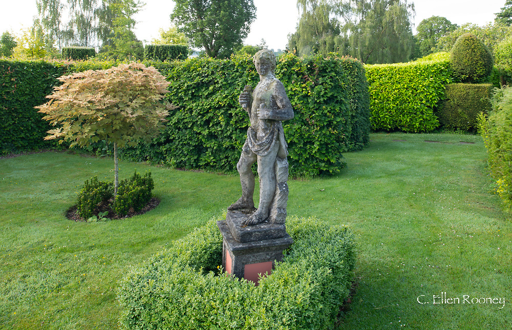 A stone statue in the Arts Garden at the Laskett Gardens, Much Birch, Herefordshire, UK