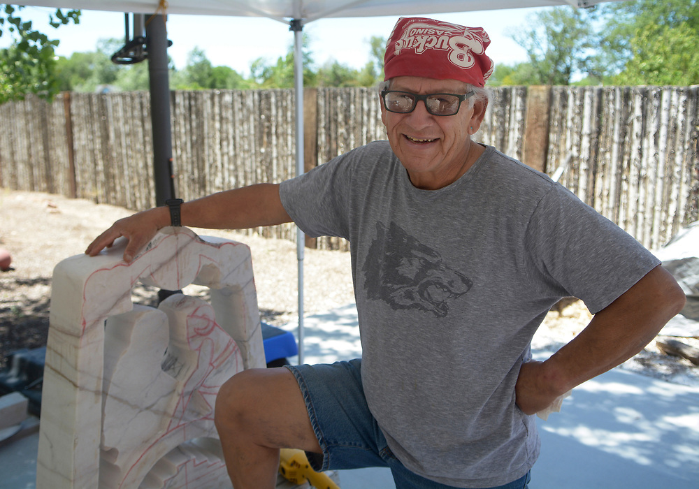gbs061317b/ARTS -- Upton Ethelbah, Jr. is working on a new sculpture of Santa Clara Pueblo ram dancers at his studio on Tuesday, June 13, 2017. Ethelbah's Portuguese marble  statue will be at the New Mexico Arts & Crafts Fair where he is the first Native American to be the featured artist.(Greg Sorber/Albuquerque Journal)