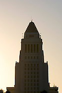 The top of the Los Angeles City Hall building in early morning light.