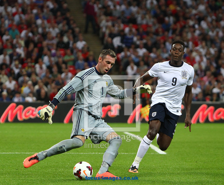 Picture by John Rainford/Focus Images Ltd +44 7506 538356<br /> 14/08/2013<br /> Danny Welbeck of England pressurises  Allan McGregor of Scotland during the International Friendly match at Wembley Stadium, London.