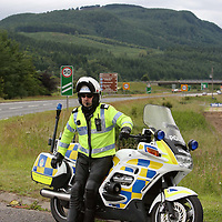 A Tayside Police motorcyclst keeping an eye on traffic on the A9 Perth to Inverness road at Ballinluig.<br /> Picture by Graeme Hart.<br /> Copyright Perthshire Picture Agency<br /> Tel: 01738 623350  Mobile: 07990 594431