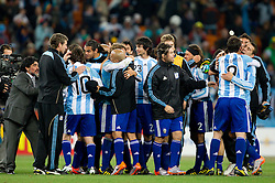 Diego Maradona (L) and players of Argentina celebrate after the 2010 FIFA World Cup South Africa Round of Sixteen match between Argentina and Mexico at Soccer City Stadium on June 27, 2010 in Johannesburg, South Africa. (Photo by Vid Ponikvar / Sportida)
