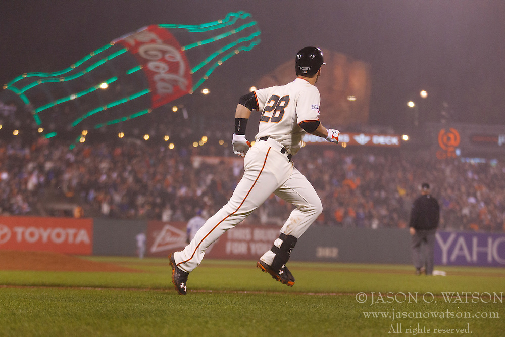 SAN FRANCISCO, CA - MAY 20:  Buster Posey #28 of the San Francisco Giants rounds the bases after hitting a two run home run against the Los Angeles Dodgers during the seventh inning at AT&T Park on May 20, 2015 in San Francisco, California.  (Photo by Jason O. Watson/Getty Images) *** Local Caption *** Buster Posey
