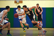 Essex's Eli DiGrande (4) dribbles the ball down the court during the boys basketball game between the Essex Hornets and the Colchester Lakers at Colchester High School on Tuesday night December 15, 2015 in Colchester. (BRIAN JENKINS/for the FREE PRESS)