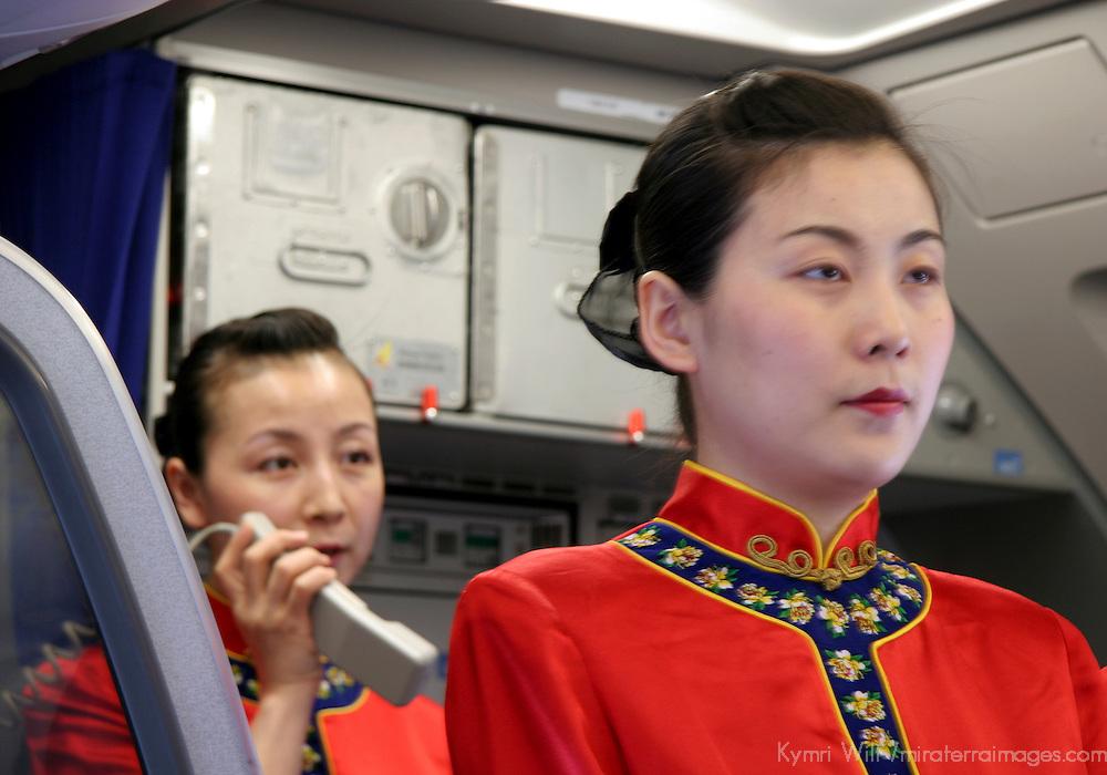 Asia, China, Xian to Chongqing flight attendants for Hainan Airlines.