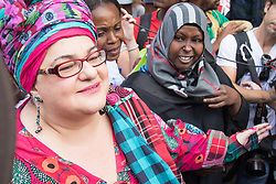 Whitehall, London, August 7th 2015. PICTURED: Kids Company founder Camila Batmanghelidjh is mobbed by supporters.   Following the closure of children's charity Kids Company in the wake of allegations of financial mismanagement, sexual impropriety and claims that some children have used money given to them to buy drugs, supporters and staff of the charity protest, marching to Downing Street demanding that the charity, set up by Camila Batmanghelidjh, be saved.