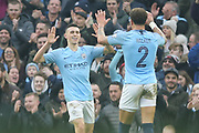 2 Kyle Walker and 47 Phil Foden celebrate the third goal for Manchester City during the The FA Cup 3rd round match between Manchester City and Rotherham United at the Etihad Stadium, Manchester, England on 6 January 2019.