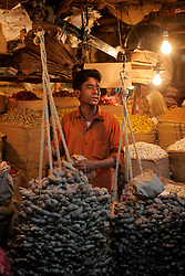 BANGLADESH DHAKA KAWRAN BAZAAR 27FEB05 - Spice trader at Kawran Bazaar vegetable market. The Bazaar has been in the Tejgaon area for at least 30 years and is one of the largest markets in Dhaka city...jre/Photo by Jiri Rezac ..© Jiri Rezac 2005..Contact: +44 (0) 7050 110 417.Mobile:  +44 (0) 7801 337 683.Office:  +44 (0) 20 8968 9635..Email:   jiri@jirirezac.com.Web:    www.jirirezac.com..© All images Jiri Rezac 2005- All rights reserved.