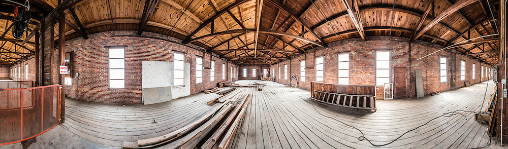 Panoramic view of second floor of Adluh Flour warehouse on Gervais Street, Columbia, South Carolina prior to renovation. Interior of the Adluh Flour warehouse in Columbia, South Carolina, prior to renovation.