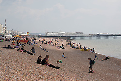 © Licensed to London News Pictures. 01/06/2014. Brighton, UK. The beach is relatively empty compared to some of the last few weekends. Despite a good start to the weekend on Saturday the up and down weather has deterred some people from coming to the beach. Photo credit : Hugo Michiels/LNP