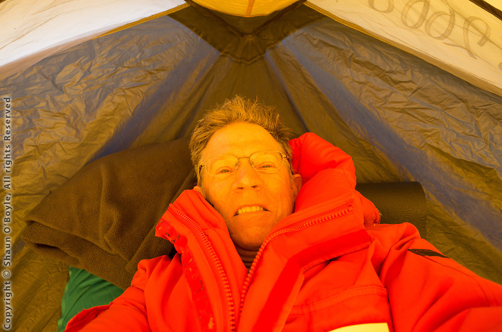 Setting up the tent for my first night camping in Antarctica. It took two to set up the tent because of the high winds.