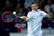 Michal Przysiezny of Poland competes at first single match during the BNP Paribas Davis Cup 2014 between Poland and Croatia at Torwar Hall in Warsaw on April 4, 2014.<br /> <br /> Poland, Warsaw, April 4, 2014<br /> <br /> Picture also available in RAW (NEF) or TIFF format on special request.<br /> <br /> For editorial use only. Any commercial or promotional use requires permission.<br /> <br /> Mandatory credit:<br /> Photo by &copy; Adam Nurkiewicz / Mediasport