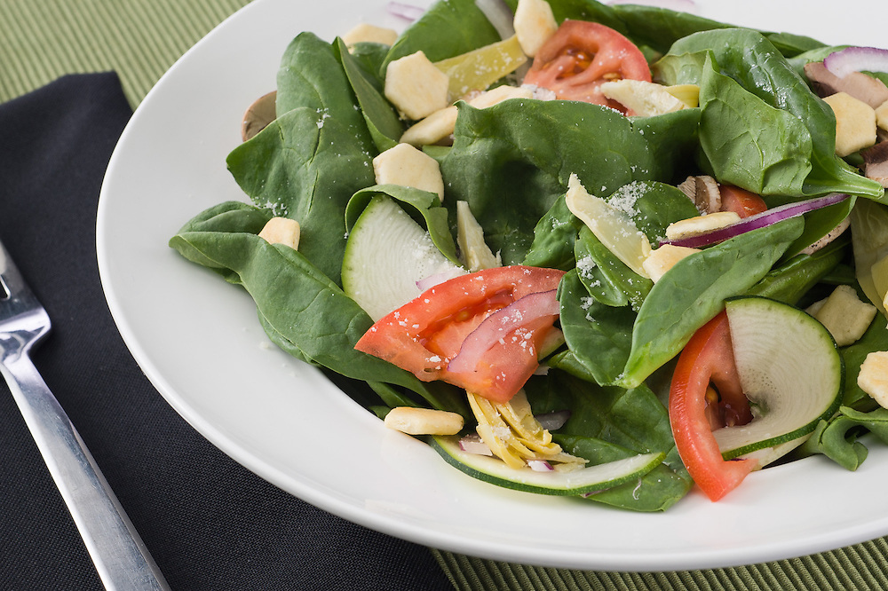 Spinach artichoke heart salad served at Craigos Pizza