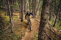 Monsoon season arrives. Syd Schulz riding the trails at Northside at Taos Ski Valley, New Mexico.
