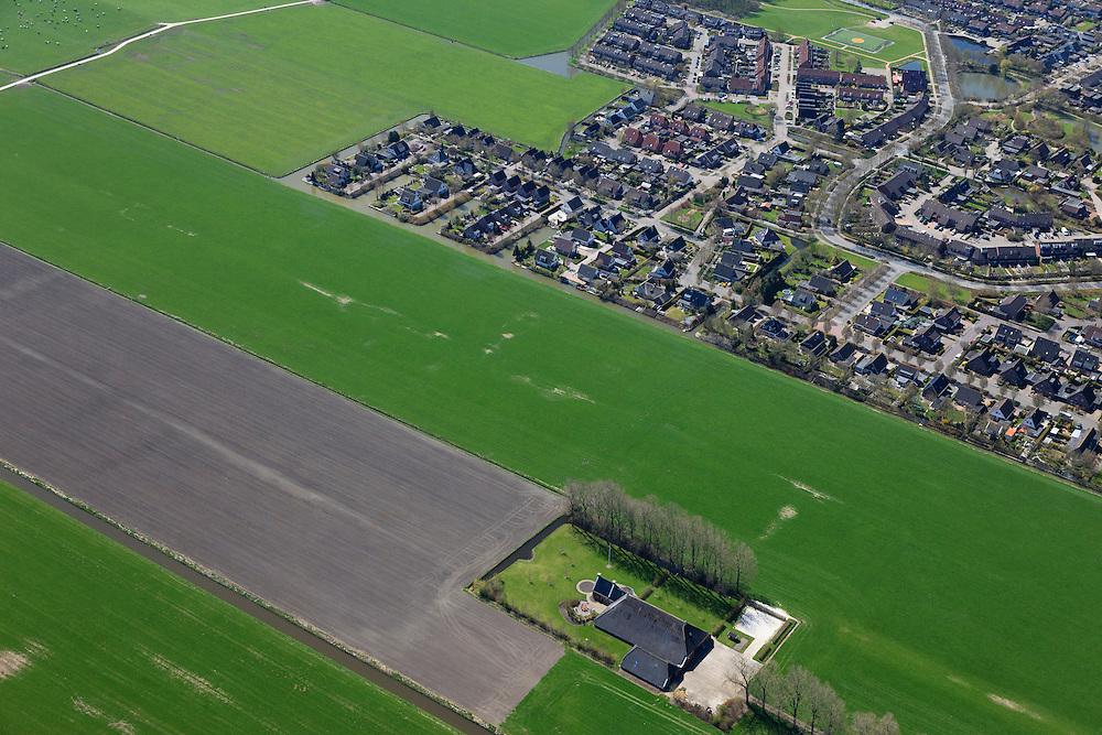 Nederland, Groningen, Bedum, 01-05-2013; dorpsuitbreiding Oosterheerd. Nieuwbouwwijk en villawijk, gebouwd in de polder, aantasting van het landschap.<br /> Oosterheerd , village expansion. New housing and residential area, built in the polder, degradation of the landscape.<br /> luchtfoto (toeslag op standard tarieven);<br /> aerial photo (additional fee required);<br /> copyright foto/photo Siebe Swart