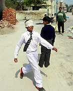 Indian boy, 10, claims his sense of smell is so strong he can identify colours, ride a bike and walk unaided while blindfolded<br /> <br /> A ten-year-old Indian boy claims to have taught himself the ability recognise colours through his sense of smell with 'mind-training'. <br /> Vikas Panchal, from Delhi, says he has also learned how to ride a bike, walk around unaided, and picking out a particular classmate from a line of fellow pupils, all while blindfolded. <br /> He claims to have developed his unusual skills by spending two hours per day practising a particular type of mind exercise technique. <br /> <br /> A video of Vikas demonstrating his abilities shows him picking up different colour balls and beads while having his eyes completely covered.<br /> After smelling them for a few seconds, he then describes the colour, even differentiating between two different shades.<br /> <br /> Other footage shows him blindfolded and riding a bicycle around his school playground and wandering around his local neighbourhood in Delhi  wearing a blindfold while dodging potholes and pedestrians.<br /> Vikas says his skills have been developed through a mind-training technique known as Midbrain Activation.<br /> It targets the stimulation of a small part of the brain that acts as a relay centre for information gathered from the body's visual, auditory and motor systems.<br /> <br /> It is claimed that people who develop their midbrain will never forget what they have seen or heard just once previously.<br /> As a result, then are said to be able to carry out everyday tasks quite literally with their eyes closed.<br /> Vikas spends two hours each day practising the technique and says it has also transformed his schooling and seen him rise to the top of his class.<br /> His trainer Shri Bhagwan, said: 'His training is like meditation. We sit in a silent place and shut our eyes.<br /> 'Everyone's mind has two parts. One part is the left side and other part is the right side.<br /