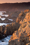 Sunset, coastal rocks and surf, Stillwater Cove Regional Park, Sonoma Coast, California