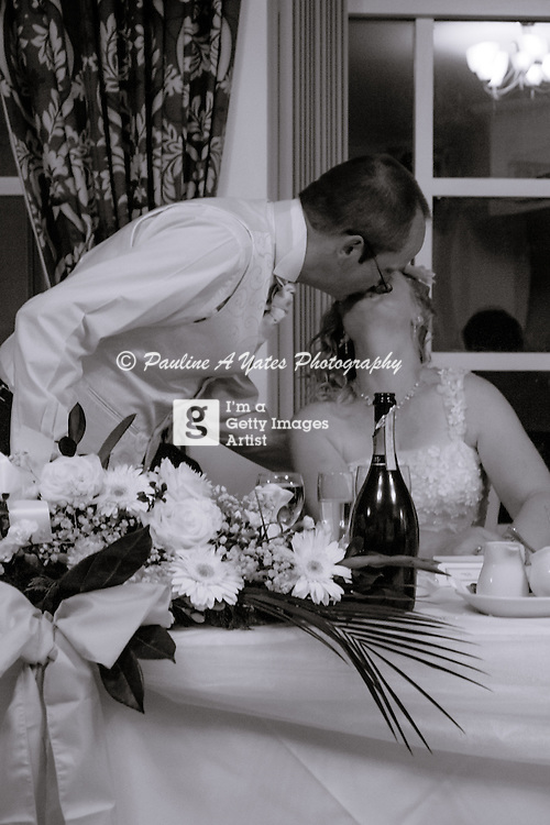 Bride and groom kissing after the groom's speech