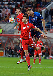 TRNAVA, SLOVAKIA - Thursday, October 10, 2019: Wales' Kieffer Moore (L) and Tom Lockyer challenges for a header with Slovakia's Norbert Gyömber during the UEFA Euro 2020 Qualifying Group E match between Slovakia and Wales at the Štadión Antona Malatinského. (Pic by David Rawcliffe/Propaganda)