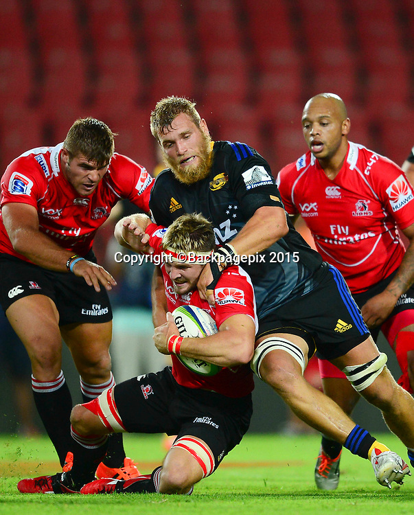 Jaco Kriel of the Lions tackled by Brad Shields of the Hurricanes during the 2015 Super Rugby rugby match between the Lions and the Hurricanes at Ellis Park in Johannesburg, South Africa on February 13, 2015 ©Barry Aldworth/BackpagePix