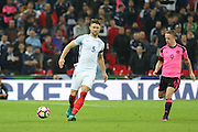 England Defender Gary Cahill battles with Scotland Forward Leigh Griffiths during the FIFA World Cup Qualifier group stage match between England and Scotland at Wembley Stadium, London, England on 11 November 2016. Photo by Phil Duncan.