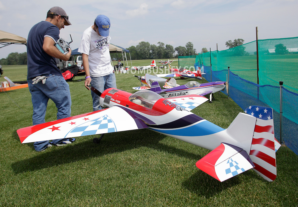 New Hampton, New York - Two men look at remote controlled airplanes at a fly-in sponsored by the Wawayanda Flying Club on June 5, 2010.