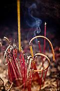 Incense sticks in a censer of Quan Thanh Temple, Hanoi, Vietnam, Southeast Asia.