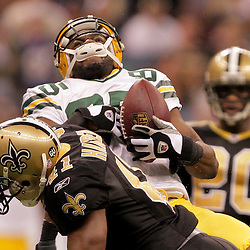 2008 November, 24: New Orleans Saints safety Roman Harper (41) puts a hit on Green Bay Packers wide receiver Greg Jennings (85) during the second half of a Monday Night Football game at the Louisiana Superdome in New Orleans, LA.