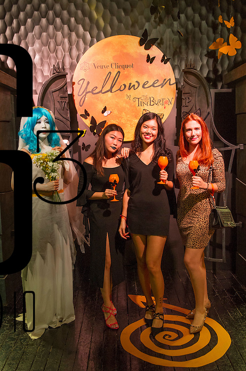 Guests pose for a photograph during the Yelloween Party for Veuve Clicquot Ponsardin on 29 October 2016 in Dragon I club, Hong Kong, China. Photo by Lucas Schifres / studioEAST