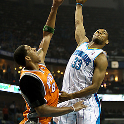 April 8, 2011; New Orleans, LA, USA; New Orleans Hornets shooting guard Willie Green (33) shoots over Phoenix Suns center Channing Frye (8) during the first quarter at the New Orleans Arena.  Mandatory Credit: Derick E. Hingle