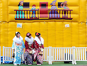 Kimono-clad 20-year-old Japanese women wait for their friends prior to a ceremony held for Coming-of-Age Day at Toshimaen amusement park in Tokyo, Japan on 14 January 2008. While Japanese women can marry as early as 16 years of age and men at 18, neither is considered to reach adulthood until they reach 20, when they can also legally begin to smoke, drink and vote.COMING OF AGE