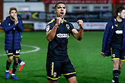 Wimbledon forward Kwesi Appiah (9) celebrates the win with the fans during the The FA Cup 3rd round match between Fleetwood Town and AFC Wimbledon at the Highbury Stadium, Fleetwood, England on 5 January 2019.
